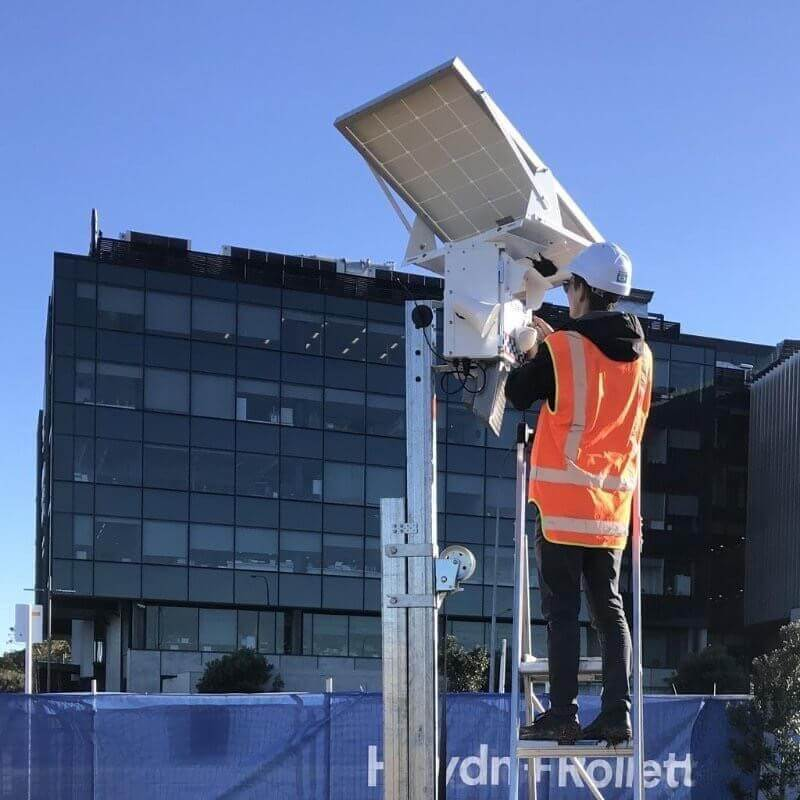 Men Setting Up A Solar Security Camera